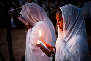 Lalibela, Ethiopia: Two young worshippers are reading the Old Testament during the old Christian (orthodox) celebration of Timkat. © Matjaz Krivic