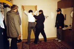 "An arrest is staged here for training purposes and documented in photographs. Dissidents were occasionally forced to reenact their own arrest for the camera. From the photobook ""Top Secret"" © Simon Menner"