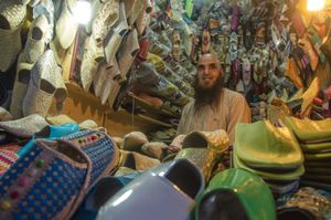 The Babouch Merchant. Fez , Morocco