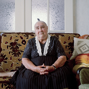 Anna Katharina Haber (b. 1926) in her garb for everyday life, Schwalm, Hessia, Germany, 2014. From the series: Village Queens. The last women in their traditional peasant garbs