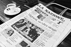 Traditional newspaper reader in Antico Caffé Poliziano