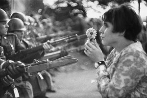 During a march on the Pentagon to protest the war in Vietnam, Jan Rose Kasmir presented a wonderful picture of peace-loving American youth. Washington D.C., 1967.
