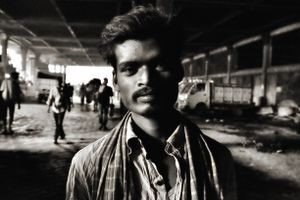 Portrait of a young man under the tunnel of Kolkata