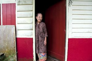 Nek Nek Lisa  has lost her memory,resides at the last village of Singapore. Her daughter moved back to take care of her and claimed however that she cant take care of her at the modern flats as she would fall even more ill due to the cramped environment.© Amrita Chandradas