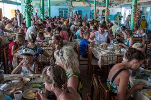 Ukraine, Zatoka Tourists eat lunch in a canteen in Zatoka, a cheap Black Sea resort destination in Ukraine popular with Moldovians.@ Petrut Calinescu