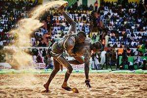 BB Bisma Ndoye defeats the wrestler Maraka Dji in the Demba Diop stadium inDakar, Sierra Leone, 05 April 2015.