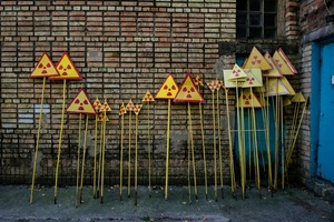 Fresh painted radiation warning signs ready to be put around the zone, Pripyat city.