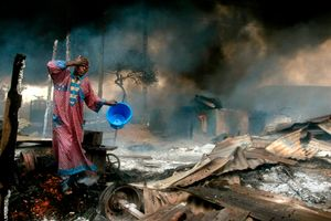 1st prize Spot News Singles, © Akintunde Akinleye, Nigeria, Reuters, Man rinses soot from his face after gas pipeline explosion, Lagos, Nigeria, 26 December