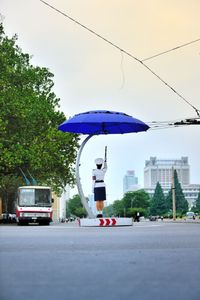 A traffic girl replaces elegantly the stop lights in Pyongyang.