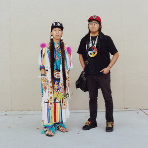 Fast Eddie (left), a pow wow dancer, is pictured with social media celebrity, Two Braids.