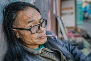 Mesib Norbu, writer and part of Free Tibet movement outside the poetry tea shop he runs in Mcleod Ganj, Himachal Pradesh, India