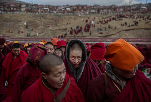 Tibetan Buddhist nuns stand following a chanting session in Sertar county, Garze Tibetan Autonomous Prefecture, Sichuan province, China, 30 October 2015.