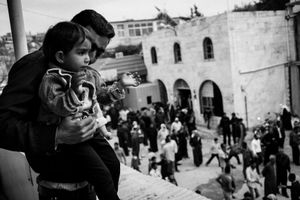 © Maciej Moskwa/TESTIGO.pl Father with child on his hands watching anti governmental demonstration on second anniversary of Syrian Revolution. March 2013, Qaalat Madiq, Hama province.