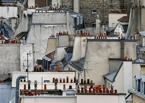 """From the series """"Paris Rooftops,"""" which Wolf made during his years in the City of Light, an iconic location that initially stymied his creative efforts. Eventually, Wolf took to the roofs, discovering a simple and appealing geometric beauty that contrasted with the heavily loaded architecture found on the street level."""