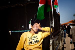 A Palestinian teenager hitching a ride away from the weekly demonstration against The Barrier, which is being built on land owned by the villagers of Bilin. February 2010 © Lars Håberg