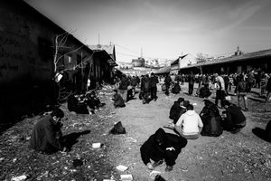Mealtime at makeshift shelter near  Belgrade main train station.  Belgrade, Serbia.