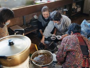 Local women are preparing their traditional new-year dishes, two kinds of soup with rice dumplings. for a community gathering.© Uma Kinoshita