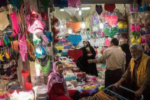 June 12, 2014 - Tehran, Iran. A woman shops at the Grand Bazaar of Tehran. © Thomas Cristofoletti / Ruom