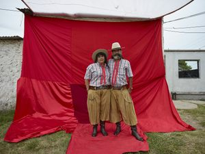 Devotees couple elegantly dressed for the chamamé dancing in the El Campito de la Carolina gathering space