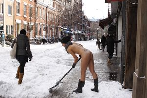 Shoveling Snow on West 4th Street. From the series, Nue York: Self-Portraits of a Bare Urban Citizen, © Erica Simone