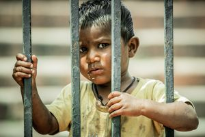 The homeless children. Behind the bars.