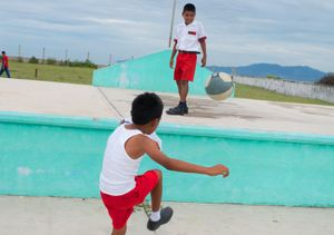 Children play football. Primary School Melchor Ocampo. Zihuatanejo.