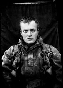 """KABUL PORTRAITS. """"Corporal first class Sander, marksman"""". Portraits of Dutch ISAF troops in Kabul, Afghanistan. The photos are taken with the antique box camera, borrowed from an Afghan street photographer in Kabul. The exposure time of each photo was 10 seconds."""