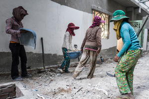 A team of female workers clear rubble from a construction site in central Phnom Penh.
