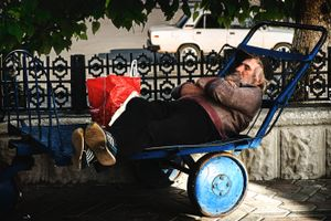 Sleeping man on a cart