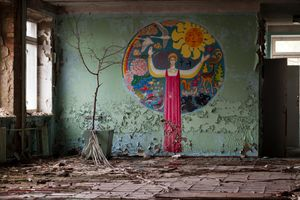 Pripyat, Ukraine, 2005. The peeling murals of an abandoned school offer just one example of the scenes of death and decay in the city. The atmosphere is one continuous poignant reminder that tens of thousands of people once called Pripyat home.