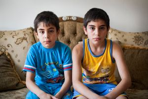 15/08/2014. Erbil, Iraq. Iraqi-Christian orphan brothers Milad (left) and Wassam are seen in at the house in Ainkawa where they are staying with their uncle.
