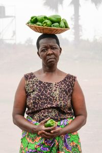 A. Rose: Widower. Sells green peppers for 500 shillings each. Earns about 20,000 shillings ($6.00) per day.