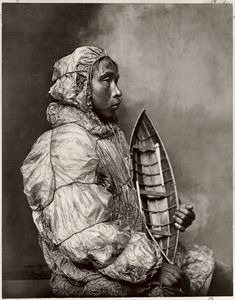 An Eskimo man models a space age-looking parka fashioned of walrus intestine, which is impermeable to water. Nome, Alaska, 1900 © Carl L. Lomen, National Geographic