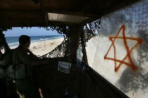 Shirat Hayam, Aug 05 - Israeli soldier watches from a watchtower the remains of the evacuated settlement © Natan Dvir