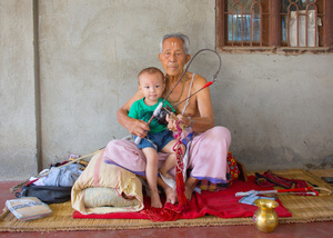The 91 year old master Pena musician of Manipur, Oja Khangembam Mangi poses with one of his grandsons.