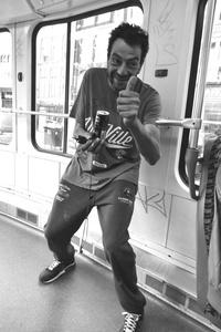 Man on Back of Tram, Amsterdam