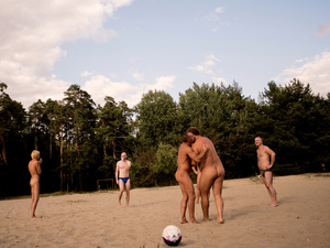 A game of beach volley in lesopark park, a gay nude beach tolerated by the local authorities for over 25 years.