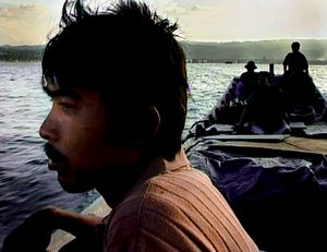 At sea, off Banda Aceh, Indonesia (2005). Fishermen - out for the first time since the Tsunami.