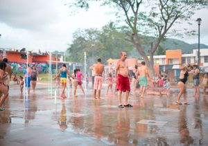 Families enjoy the communityfountains on a summer afternoon. Zihuatanejo.