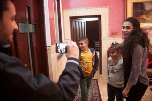 15/11/14. Alqosh, Iraq. Salam's daughter Adriana (right) and family friend William visit Wassam (second left) and Milad (second right) at the orphanage.