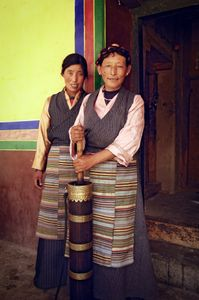 These women are villagers at Mindroling Monastery near Dranang, Tibet. They were photographed with a churn used for making yak buttter tea on 1 July 2005. © Forest McMullin