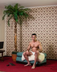 """""""Bucharest, Romania, April 2016: A 33-year-old cam model after his day shift in a room at Studio N2"""". From the Series """"Live Chat Studio Industry""""."""