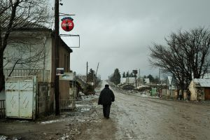 A man walks down the main street of Gorelovka.