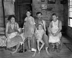 "Sharecropper Bud Fields and his family at home. Photo from ""Let Us Now Praise Famous Men."" © Walker Evans. Published by Houghton Mifflin Company"