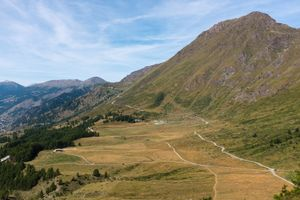 The old military road Strada dell'Assietta, Piemonte, Italy, snakes upward toward the horizon, commencing its 60km path, almost all above 2,000m following the ridge separating the Susa and Chisone valleys, to Sestriere