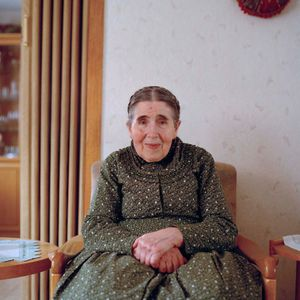 Katharina Hofmann in her home, Catholic Marburger Land, 2015. From the series: The last women in their traditional peasant garbs