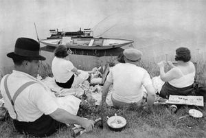 "Sunday on the Banks of the Marne. From ""The Decisive Moment."" © Henri Cartier-Bresson / Magnum. Published  by Simon and Schuster in the US and Editions Verve in France. Most recently reprinted by Steidl."