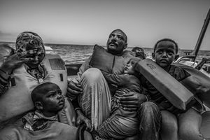 A Sudanese family moments after being rescued by the MOAS team