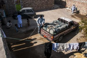 Smugglers enter diesel depots at sunset. The depots are built where smugglers live, increasing the risk of fire in their houses. After filling the fuel cans, the smugglers set out for the Pakistan border. Every vehicle carries almost 2,000 liters of fuel.