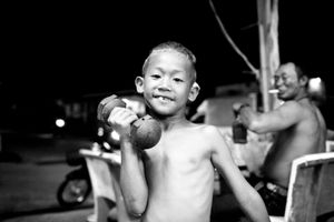 A boy, 7 years, wants to become a famous boxer. His father in the background is his trainer. © Sandra Hoyn